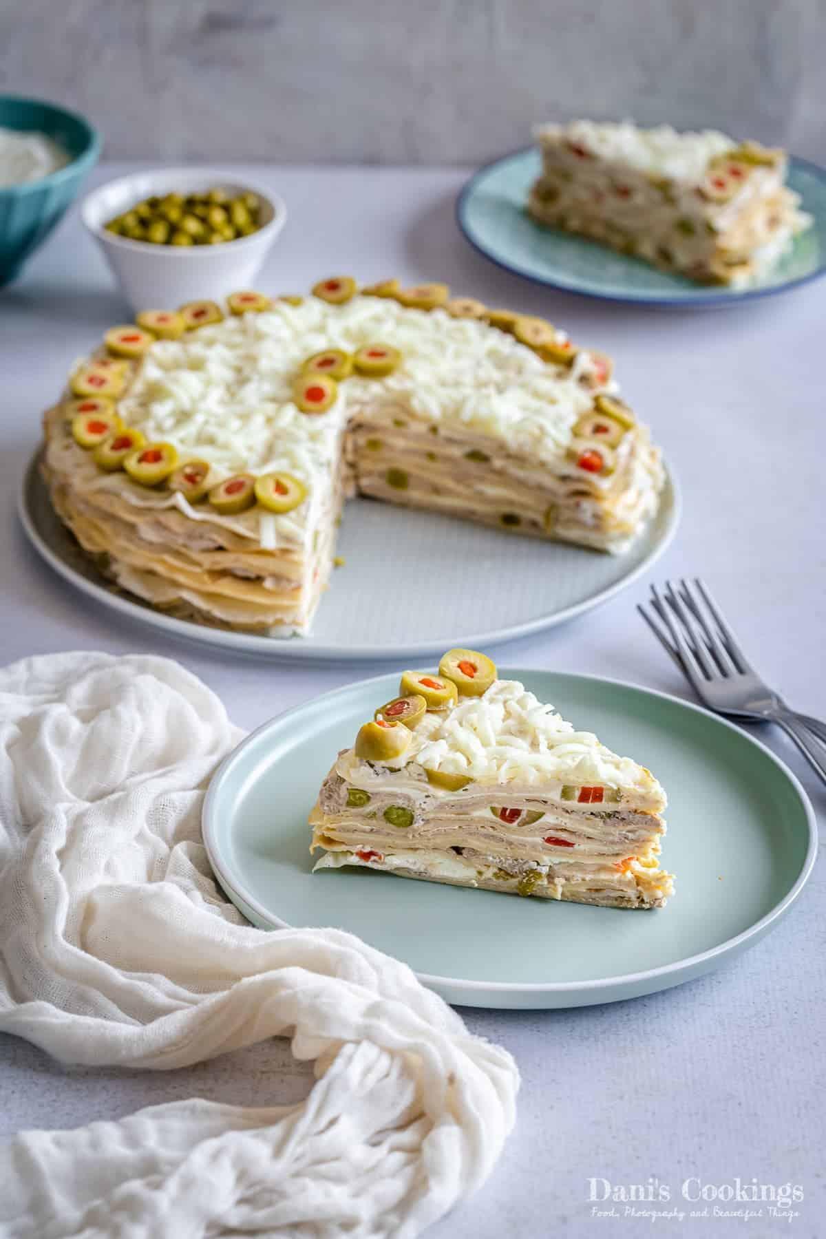 a sliced savory crepe cake on a table