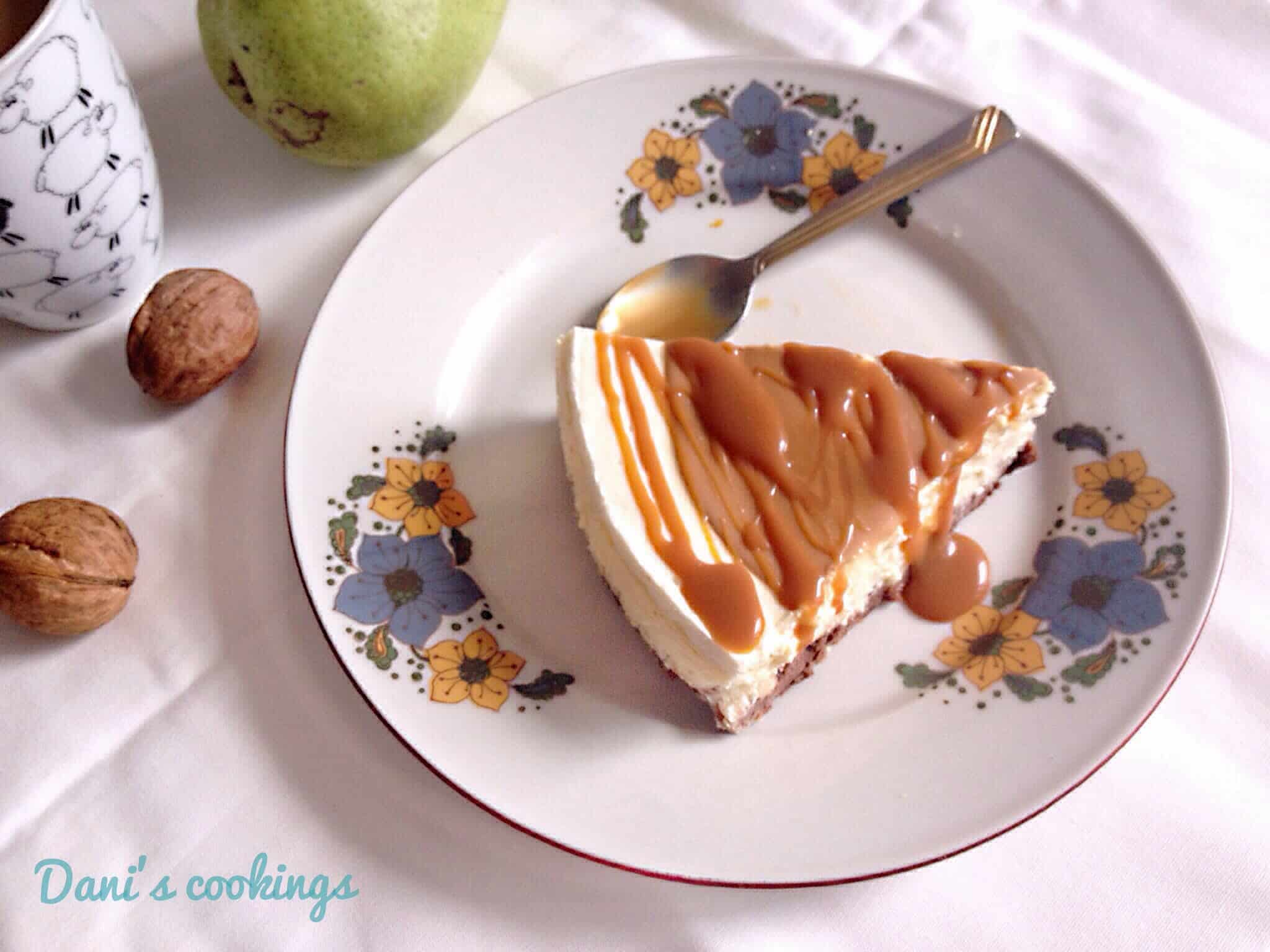 a slice of cheesecake with caramel on a plate with flowers