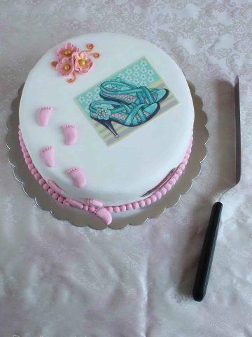 funfetti cake with fondant decoration and a spatula
