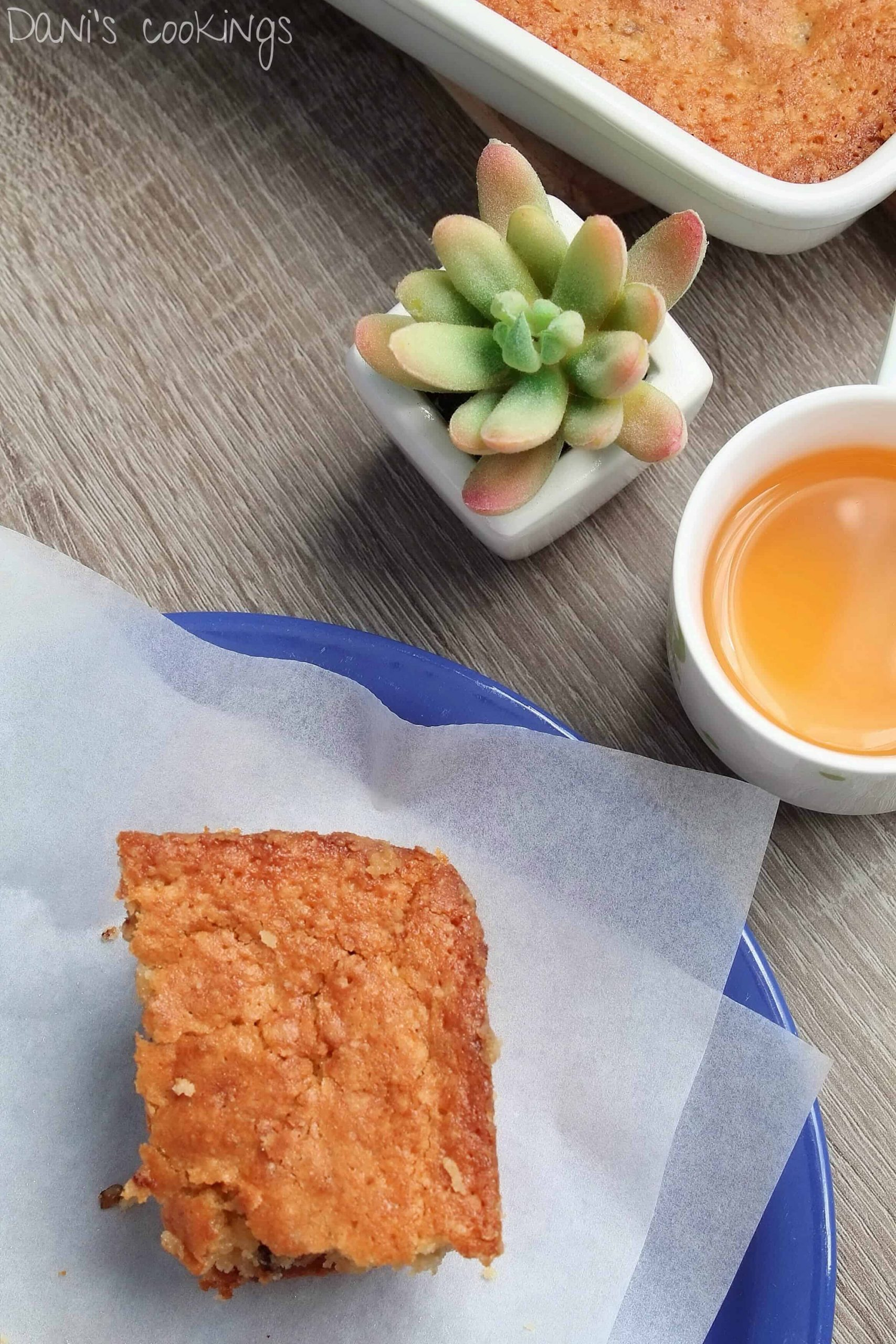 one blondie on a plate with tea aside