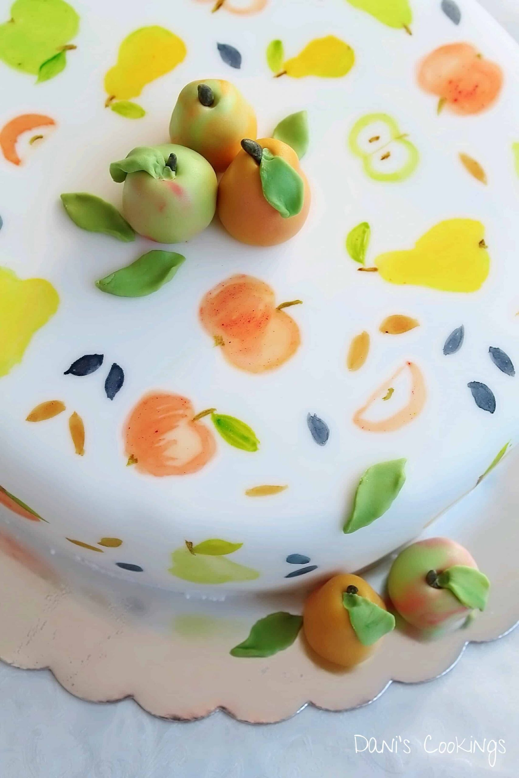 layer cake decorated with painted and fondant fruits - daniscookings.com