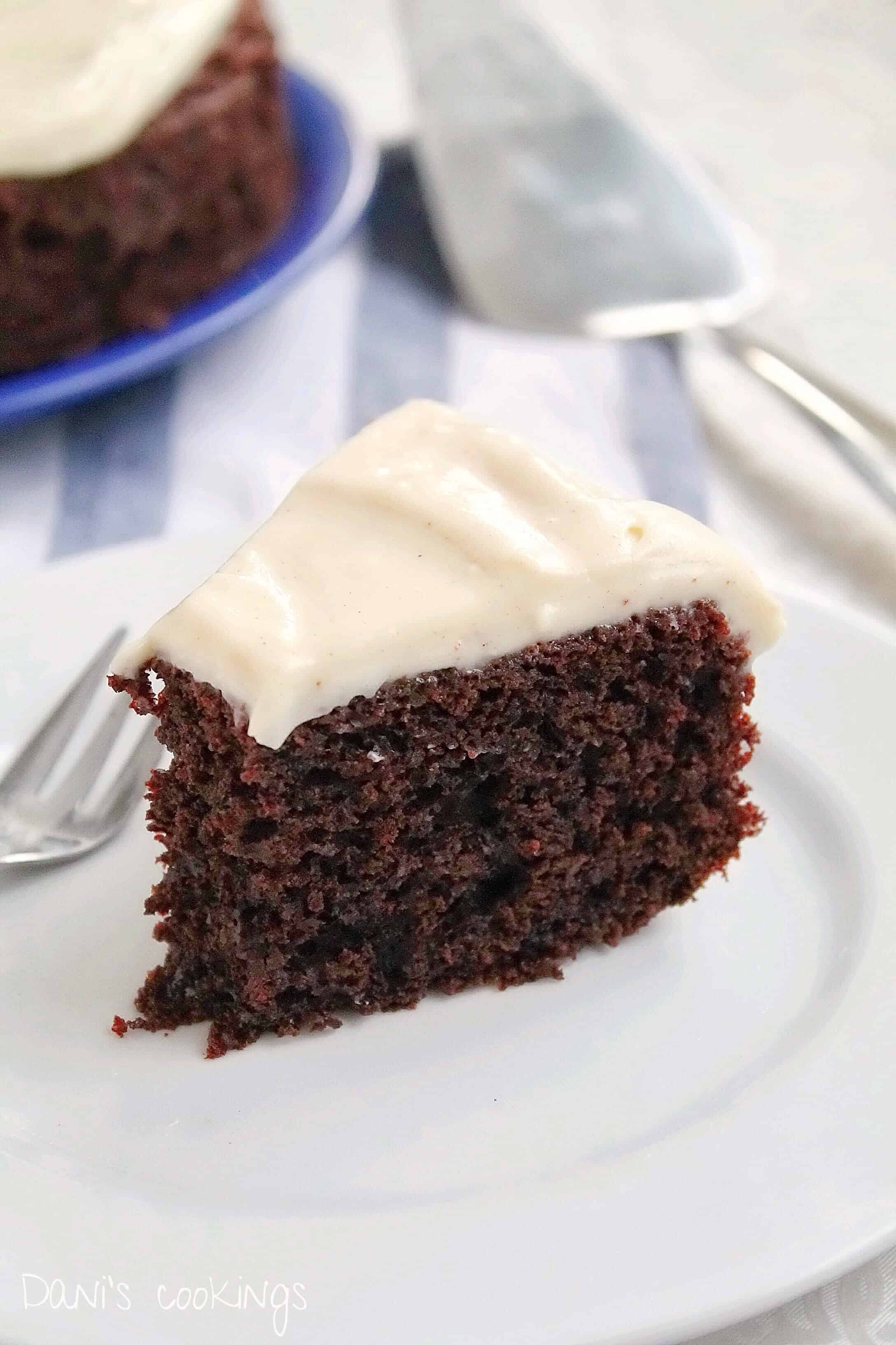 a slice of double chocolate cake being eaten