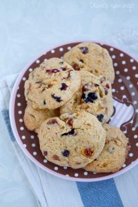 a plate full of cookies with dried fruits