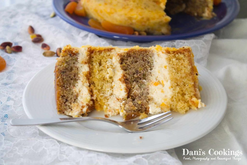 An incredibly delicious decadent lemon pistachio cake with apricot frosting
