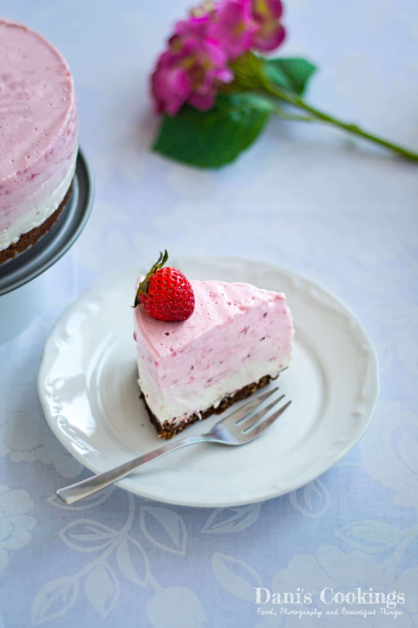 a slice of strawberry ombre cheesecake on a plate