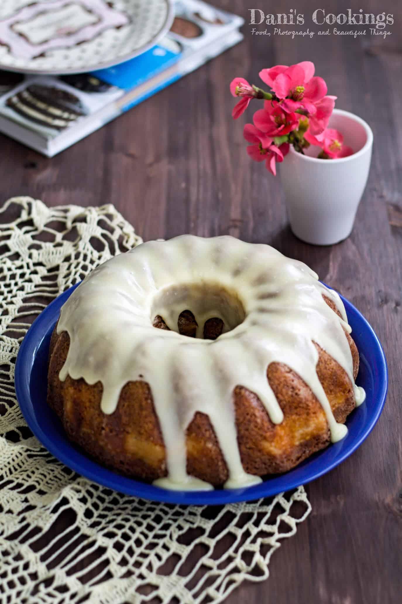 a bundt cake with white glaze on a plate