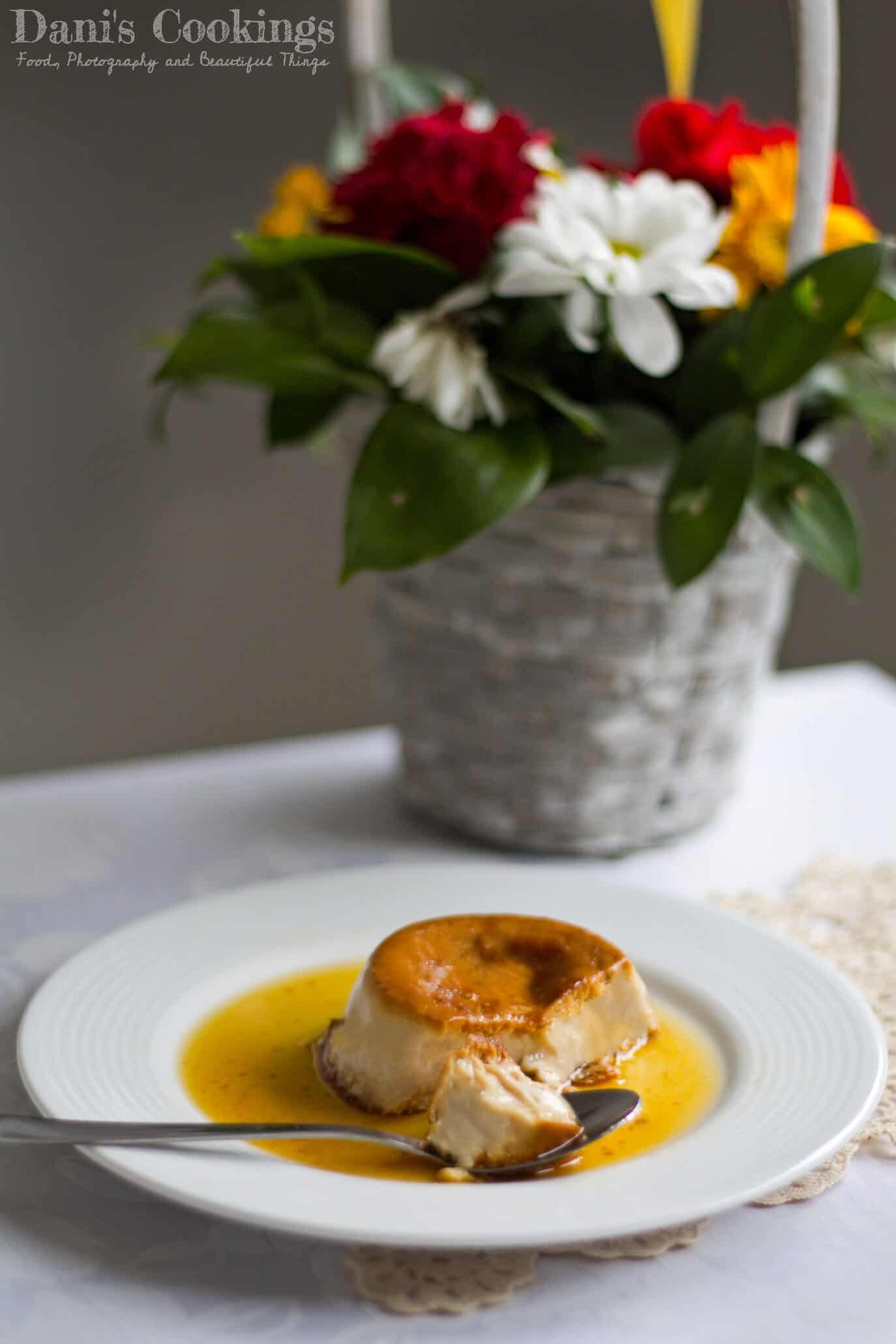 creme caramel eaten on a plate with flowers aside