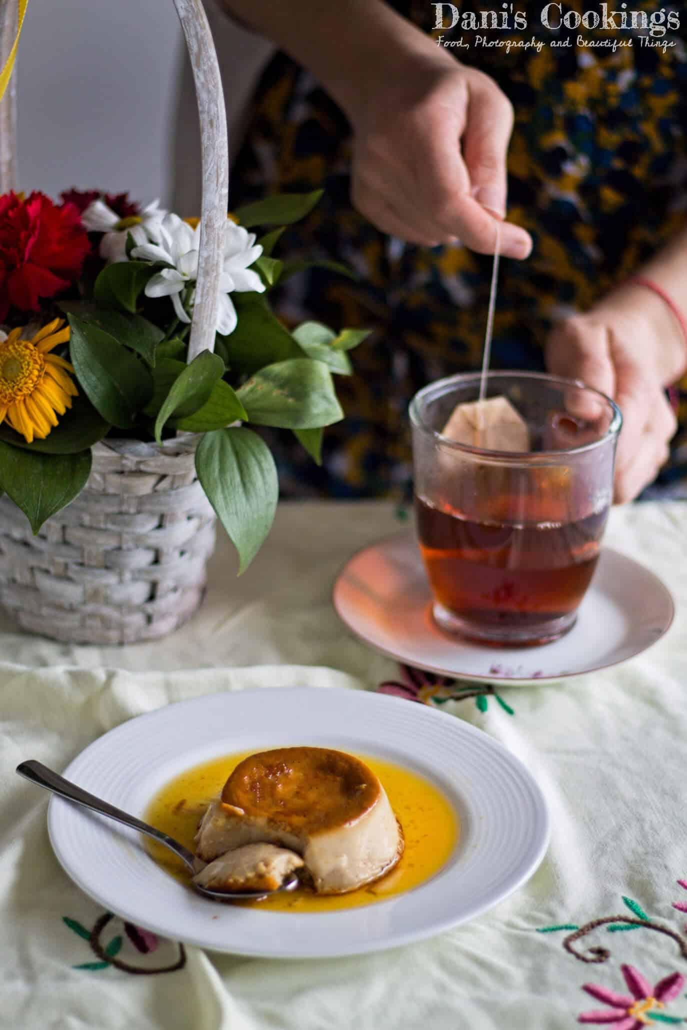 a woman infusing a tea bag with creme caramel aside