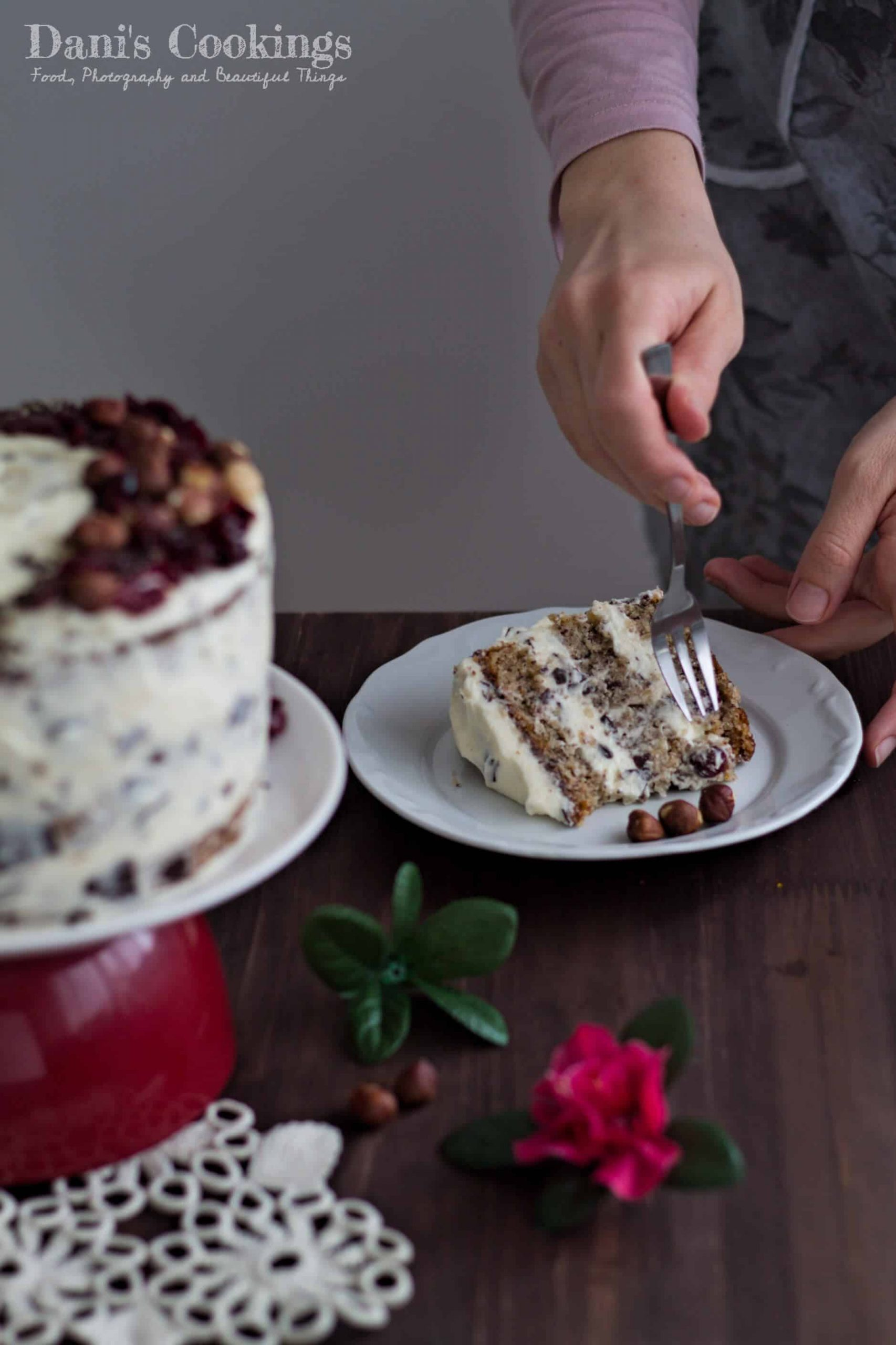 a woman eating a slice of cake