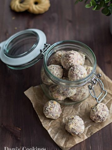 a jar full of truffles with cookies aside