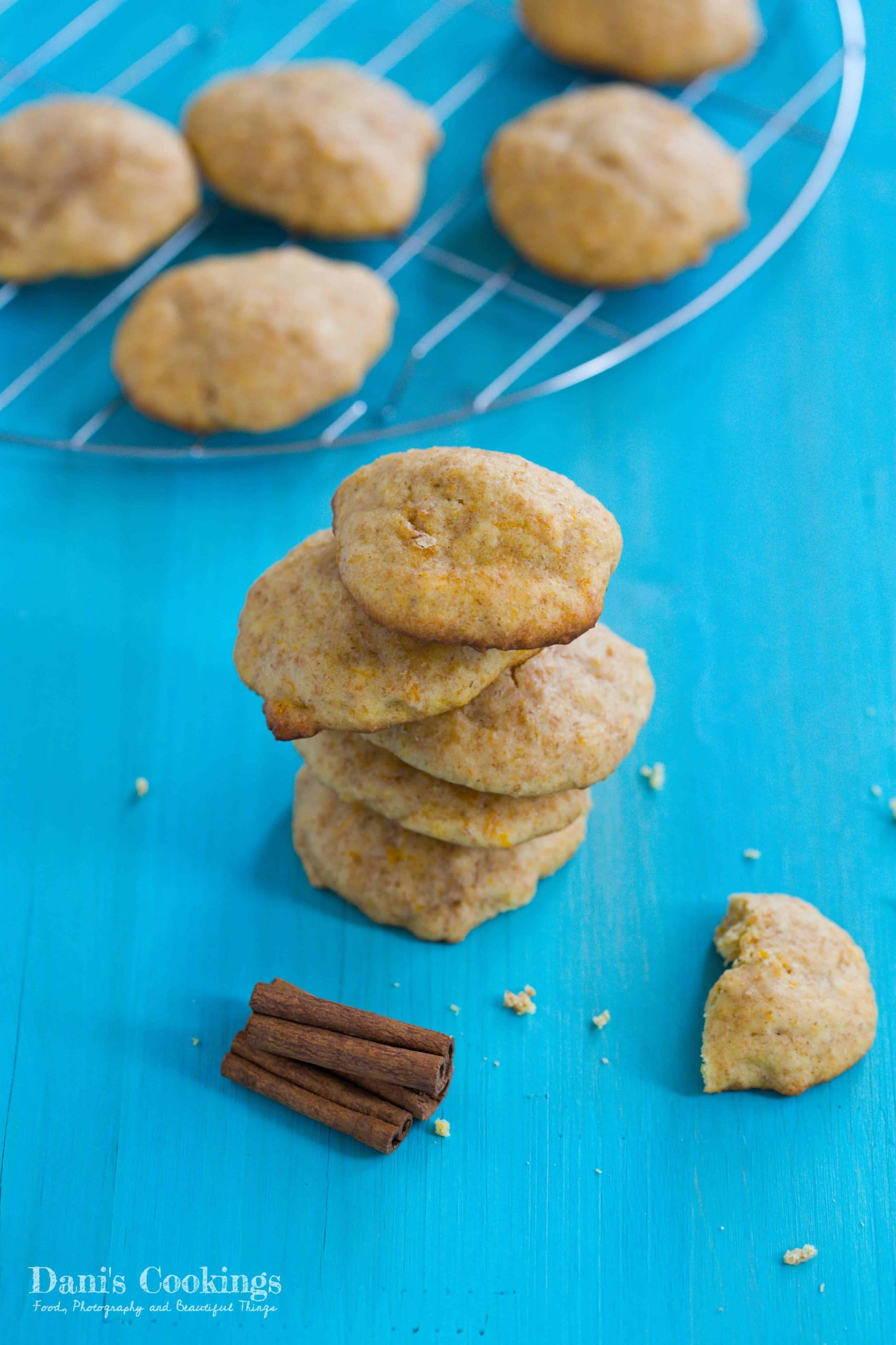 stacked pumpkin cookies with more on the back