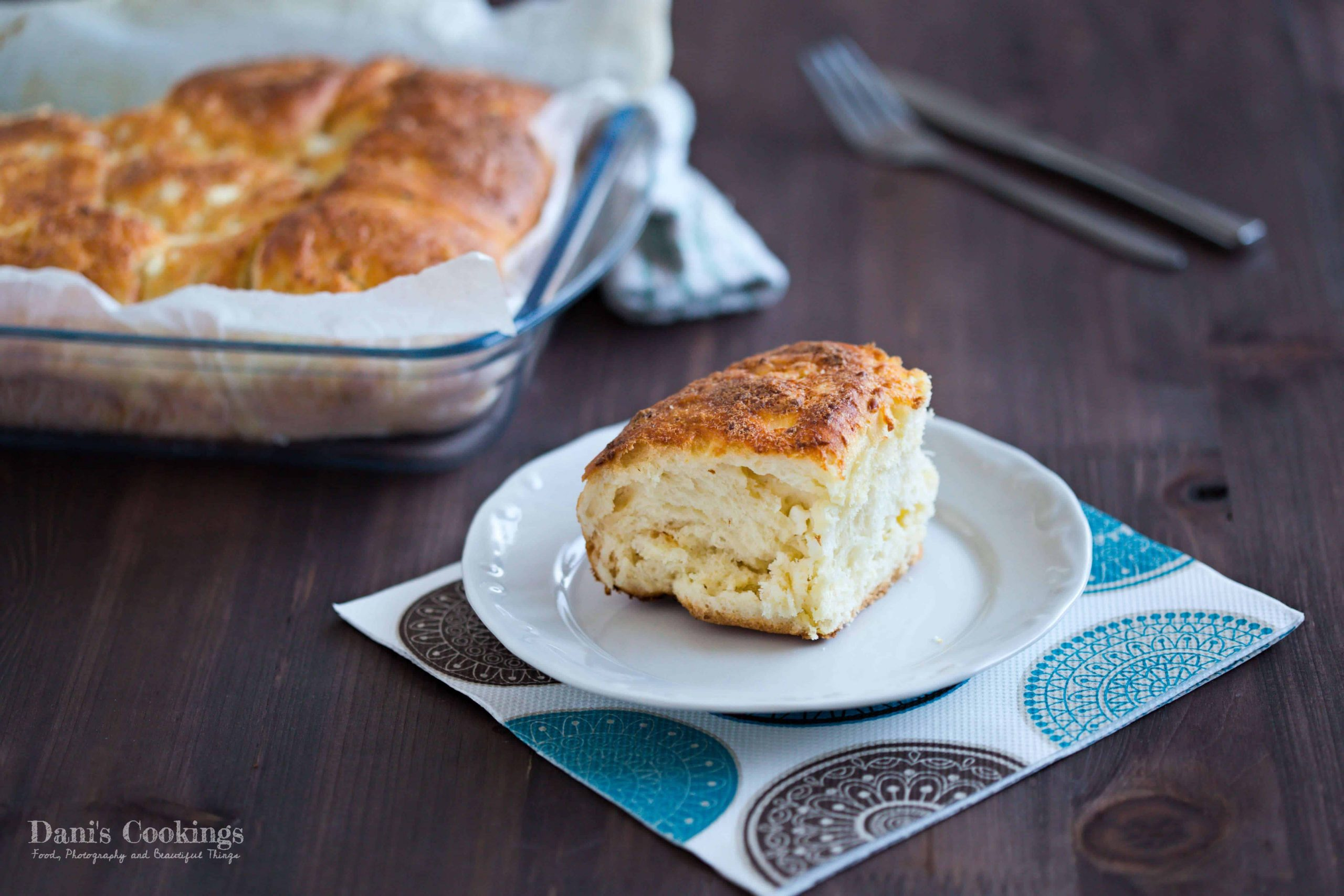 a slice of cheese bread on a white plate