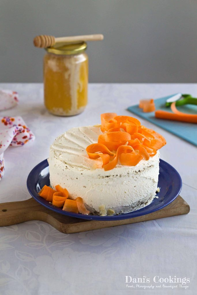 Healthy Carrot Cake with Almonds and Hazelnuts | Delicious carrot cake decorated with raw carrot stripes | Guilt free carrot cake with honey, ricotta and mascarpone frosting | Find the recipe at daniscookings.com