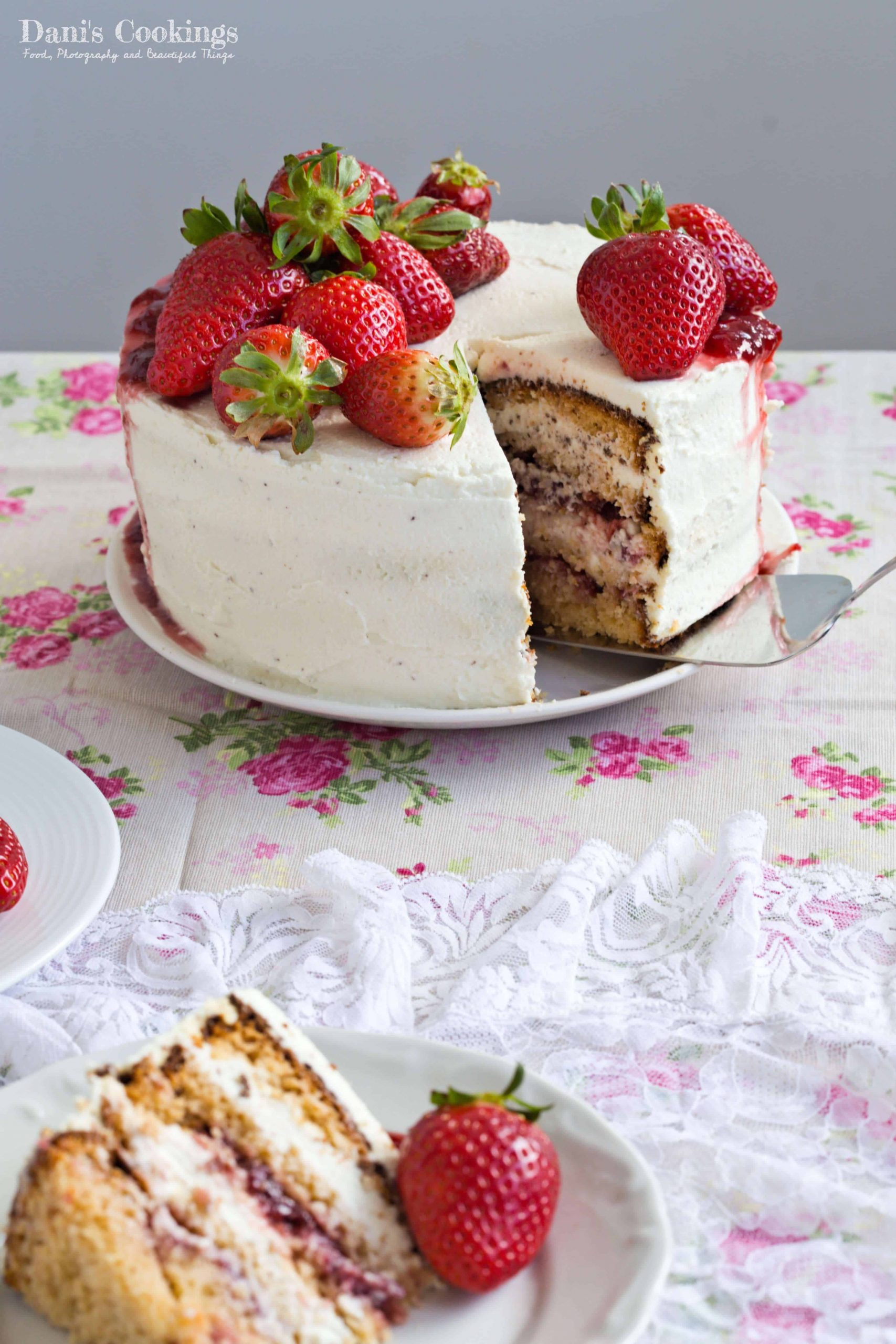 a sliced cake with strawberries