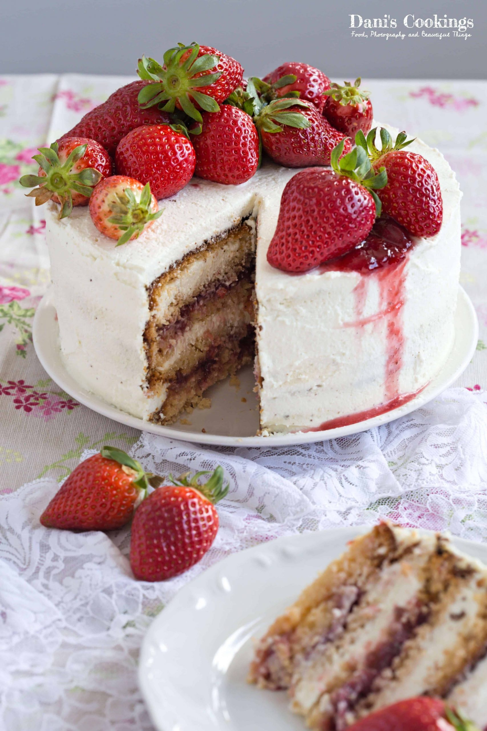 a cake with strawberries and jam on top