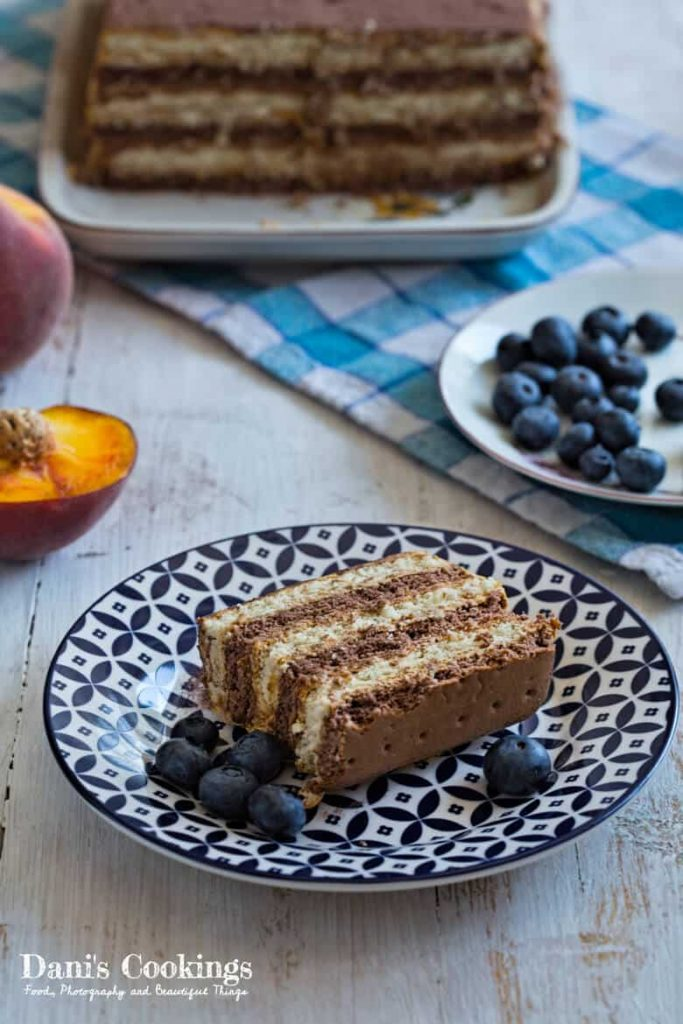 Easy icebox cake with Dulce de Leche - cake and slices. Peaches and blueberries on the side