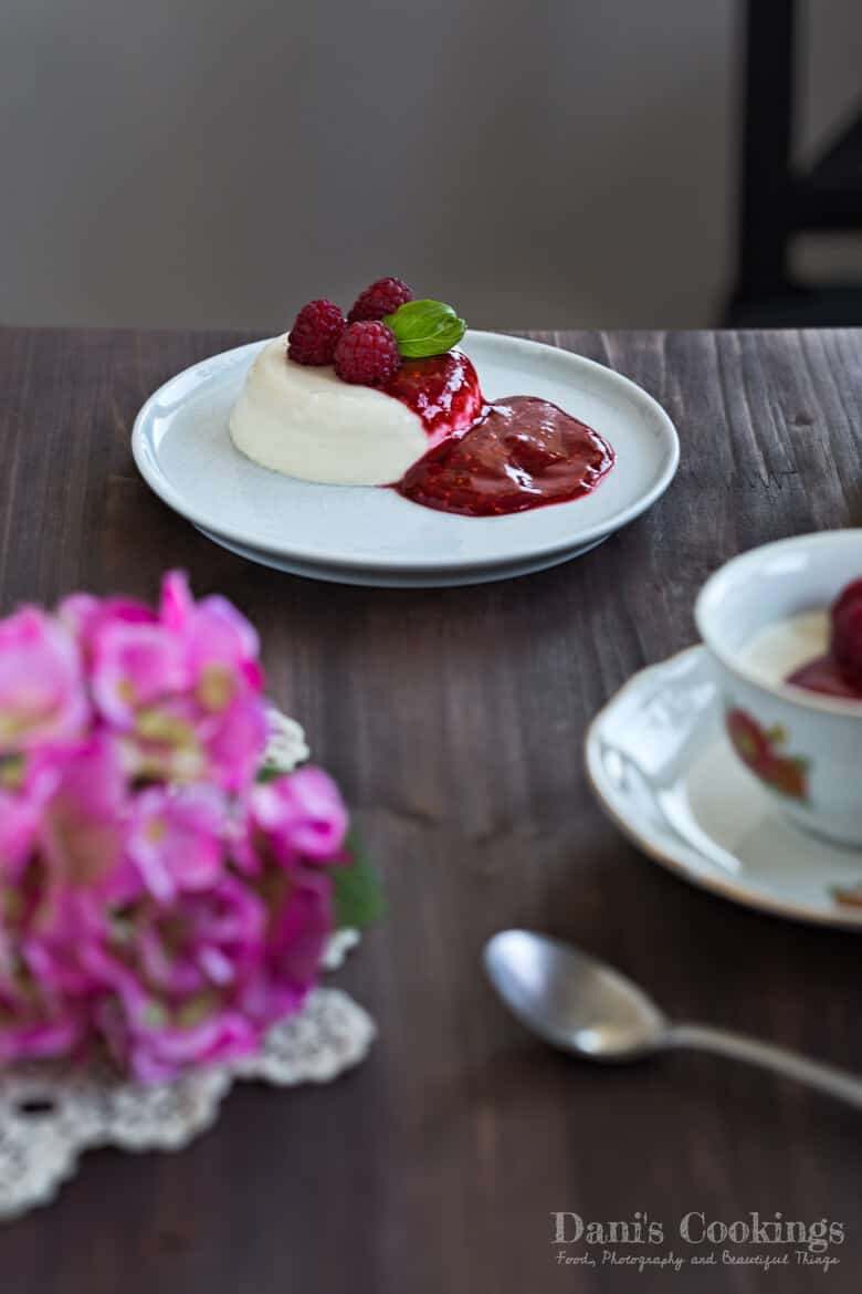 a plate with panna cotta on a table