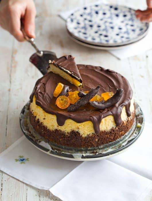 Classic baked cheesecake is among the best desserts on earth! This wonderful Orange Cheesecake with Chocolate Glaze is easy, simple and really delicious!