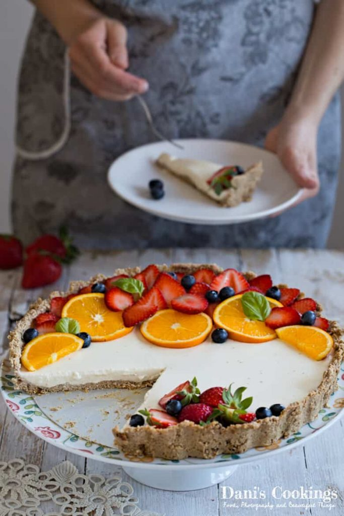 Healthy Orange Berry Panna Cotta Tart, flavoured with orange zest and decorated with fresh berries! It is a really nice dessert that all your family would appreciate!