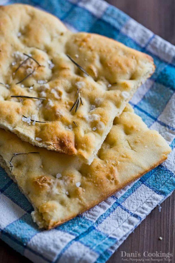 fociaccia bread on a blue tea towel
