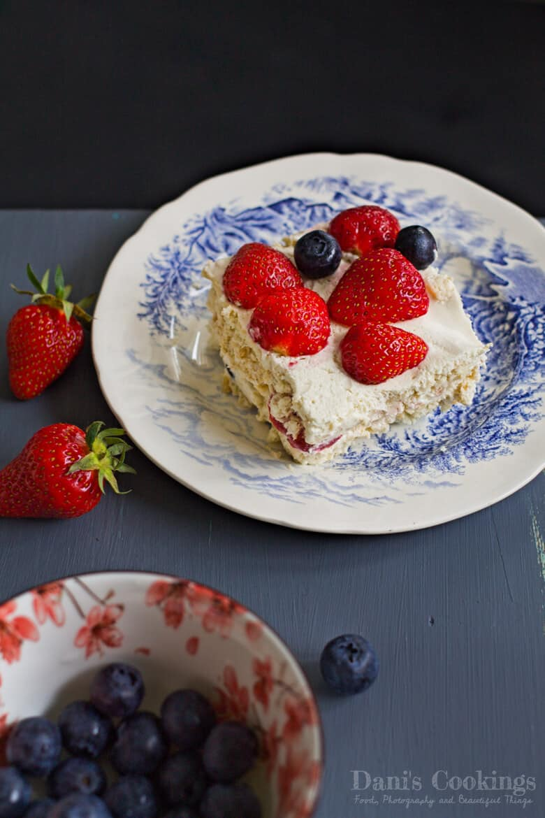 Ice Box Cake served on a plate with berries