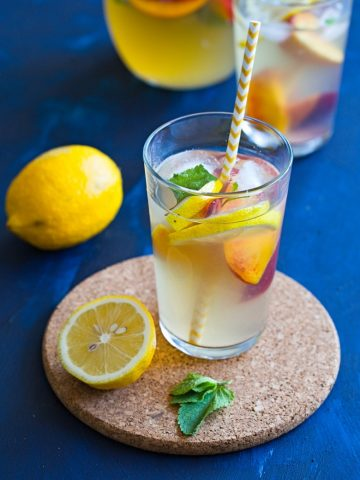Homemade Iced Tea Recipe - a refreshing drink served in glasses with lemon, mint and fresh fruits