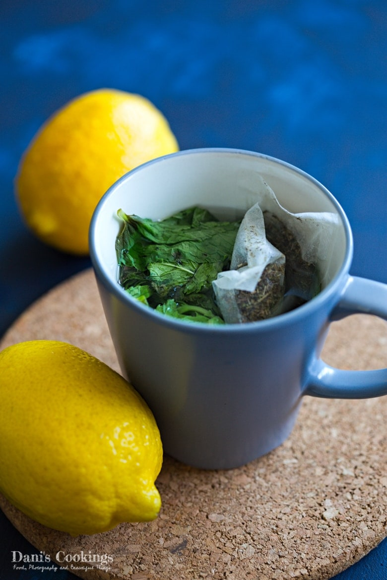 a cup of tea with herbs being infused
