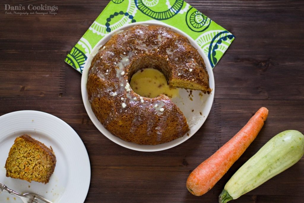 Zucchini Carrot Cake Recipe served in a white plate on a wooden table