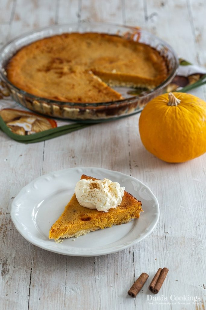 Easy and delicious pumpkin pie served on a wooden table