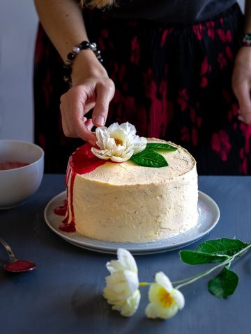 keto birthday cake decorated with an artificial flower