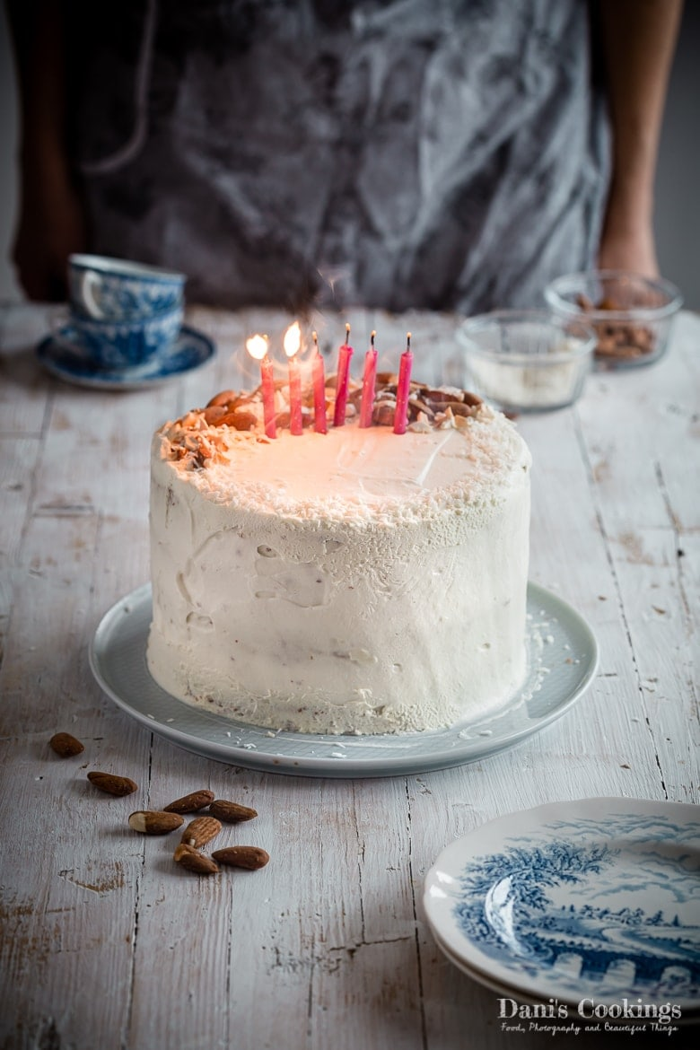 a woman in front of a cake with candles