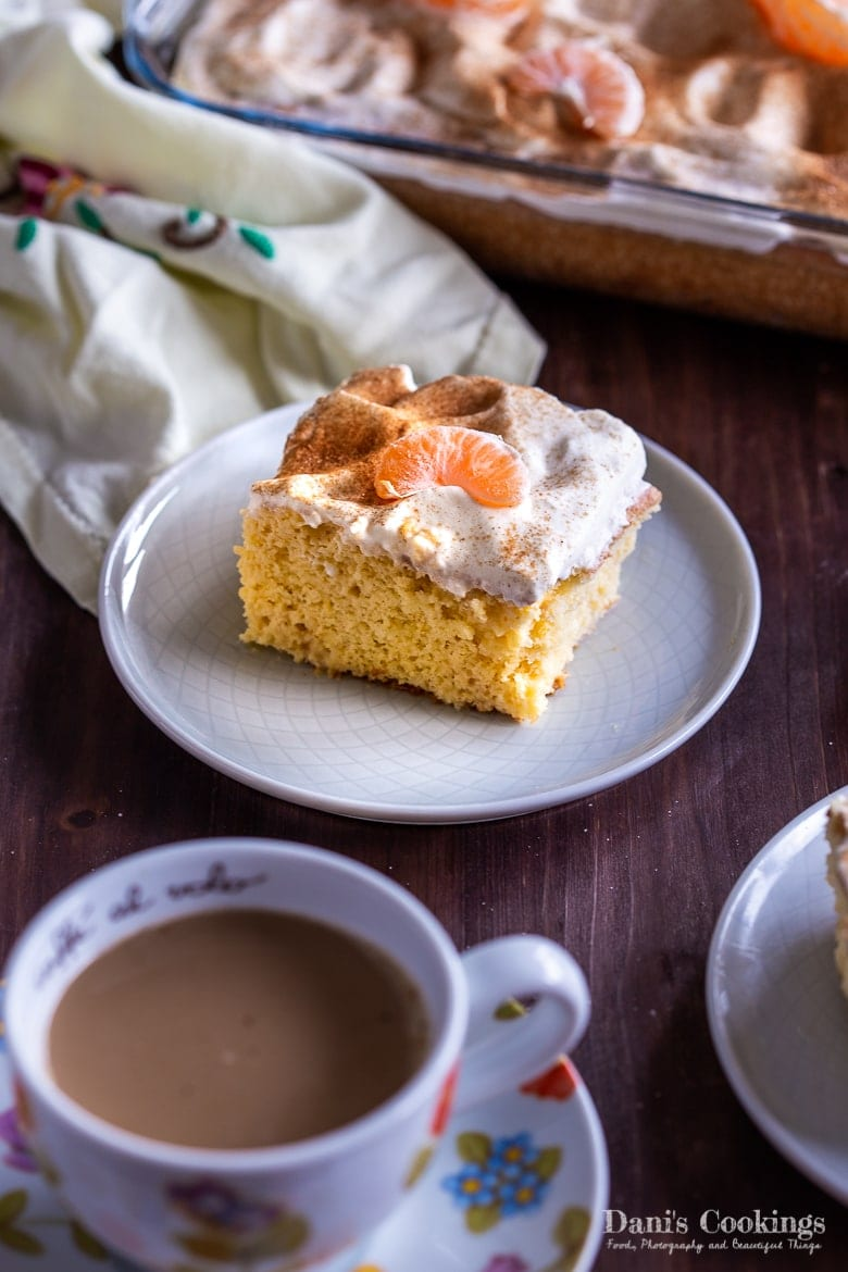 Easy Tres Leches Cake served on a plate with coffee