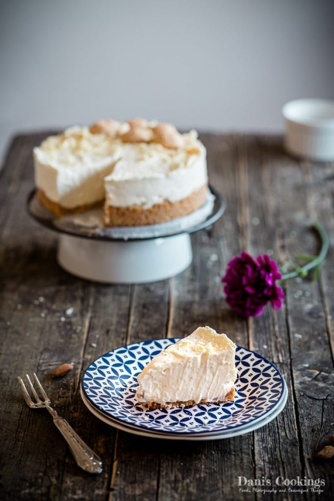 No Bake Amaretto Cheesecake served on a wooden table