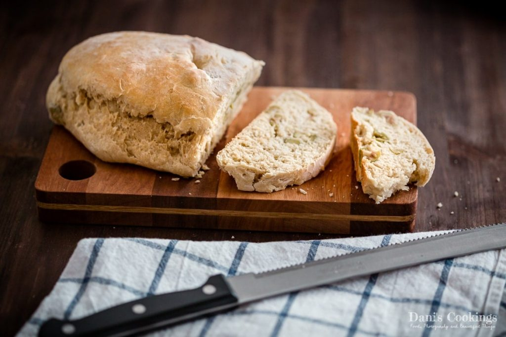 Easy Rustic Olive Bread cut on a wooden board