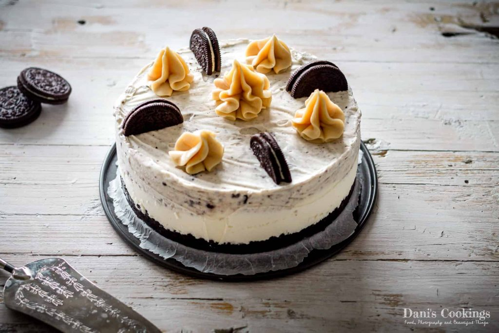 Oreo Cheesecake Ice Cream Cake served on a wooden table