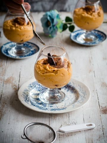 Sweet Potato Mousse served with chocolate and cocoa powder in a glass