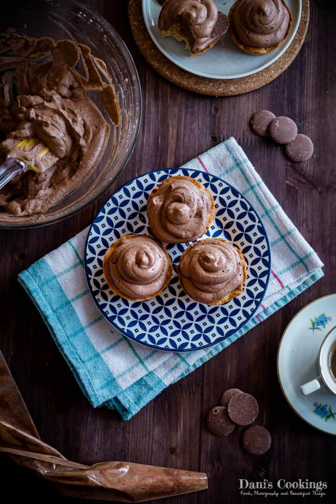 Cookie Cupcakes with Chocolate Mousse on a plate with frosting and coffee around