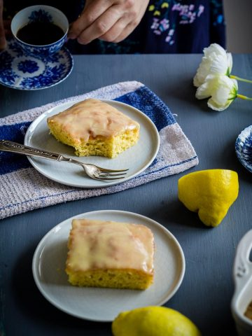 Lemon Brownies served on blue table with coffee
