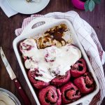 Red Velvet Cinnamon Rolls served with frosting