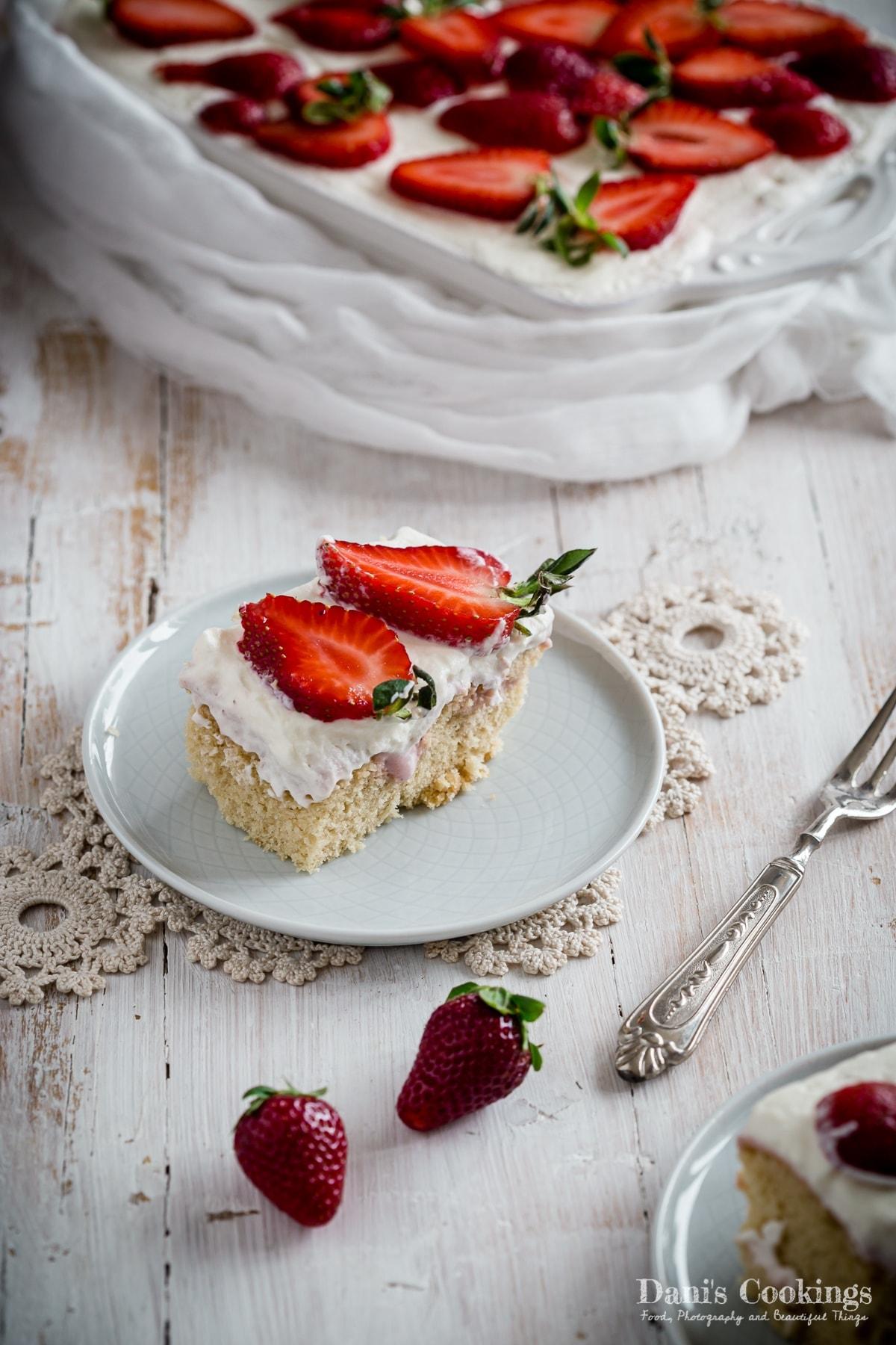 a slice of Strawberry Cheesecake Poke Cake on a plate