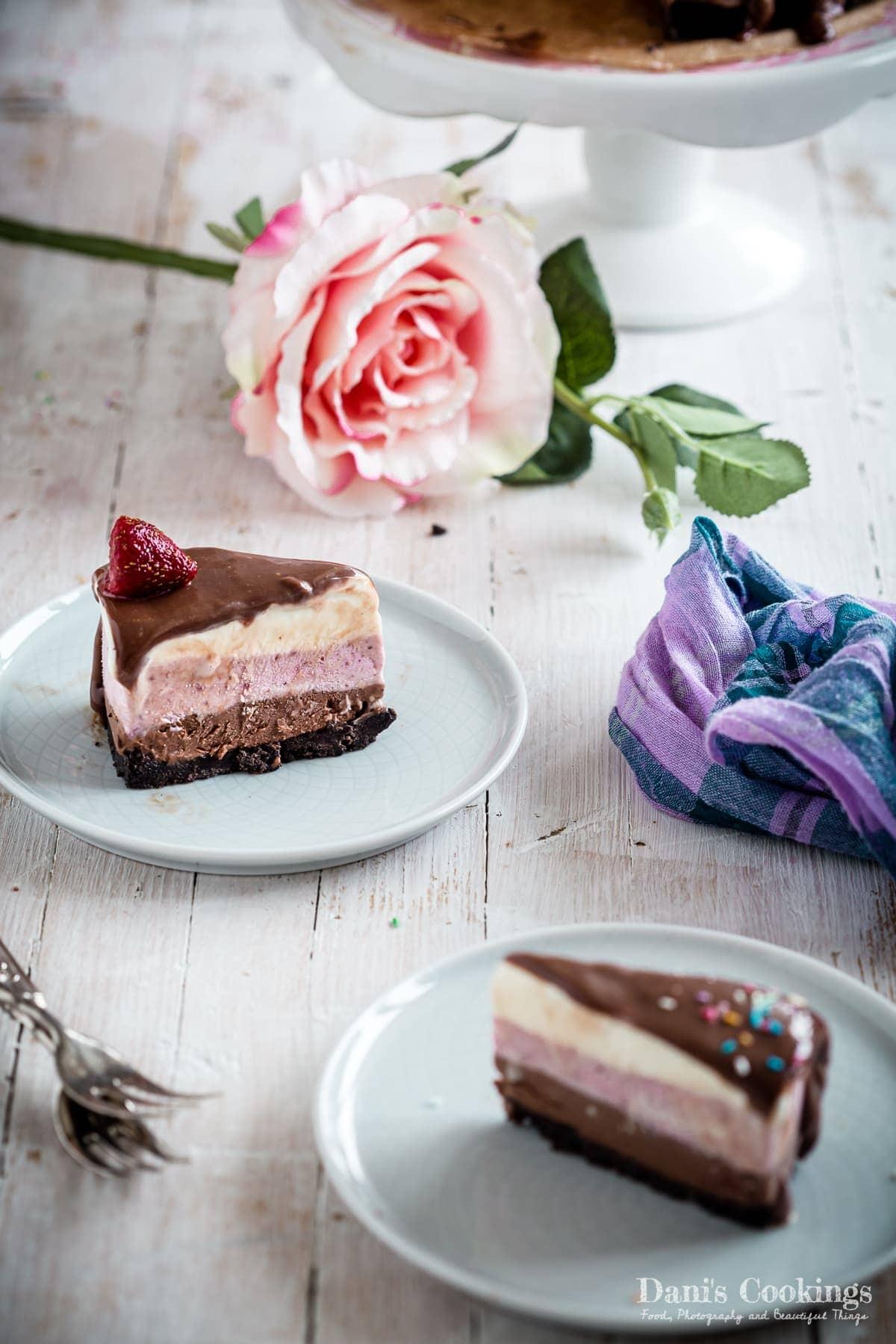 two slices of neapolitan ice cream cake
