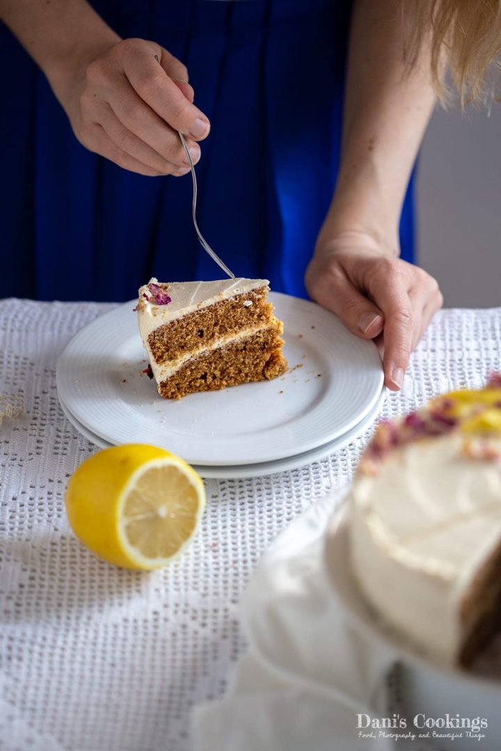 A woman about to eat a slice of olive oil cake