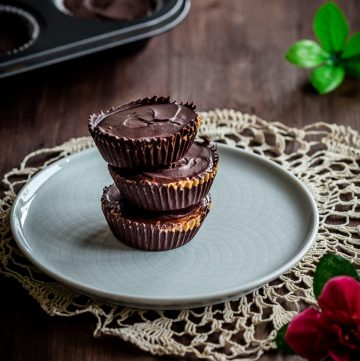 three stacked peanut butter cups on a plate