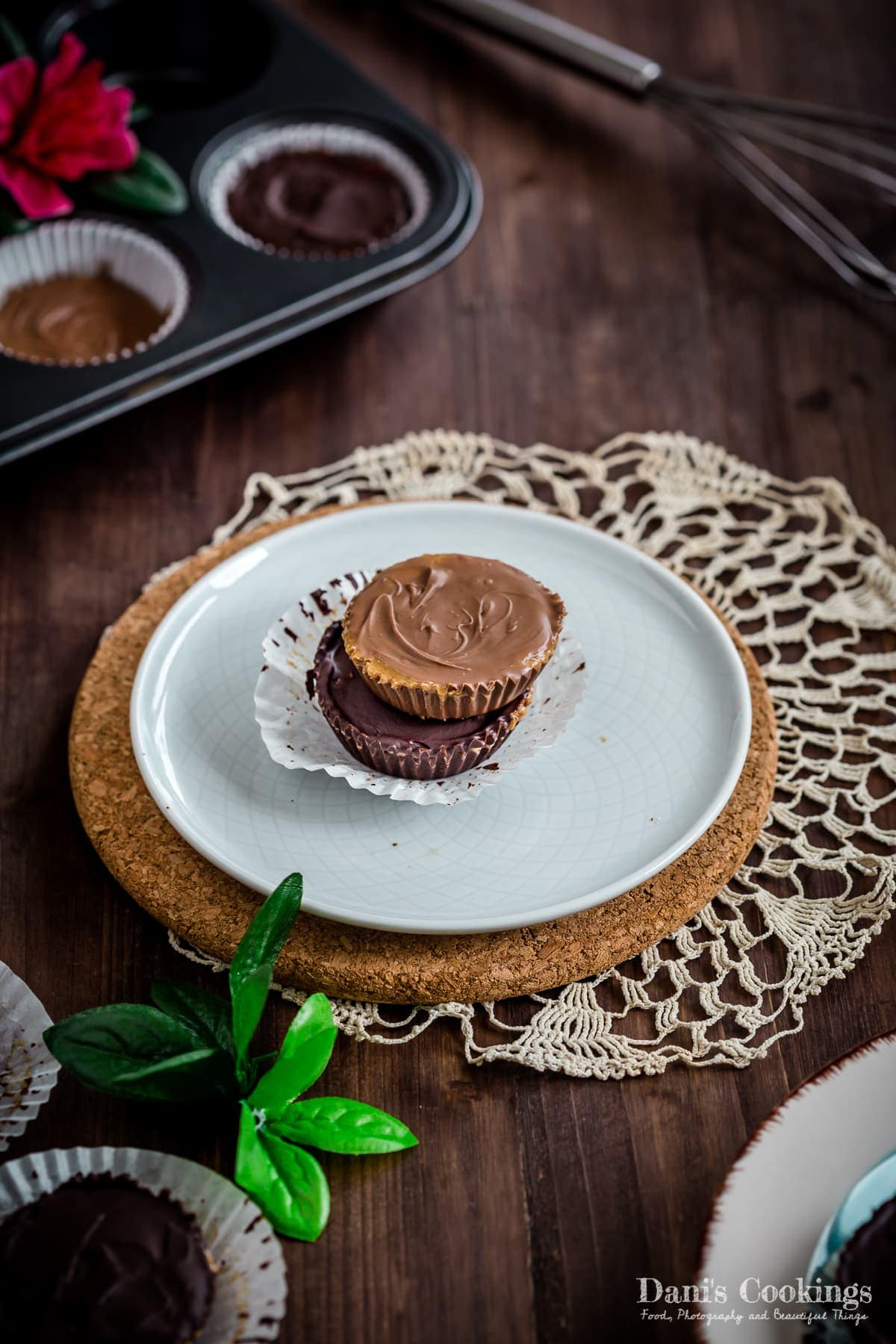 two stacked peanut butter cups: with milk and dark chocolate