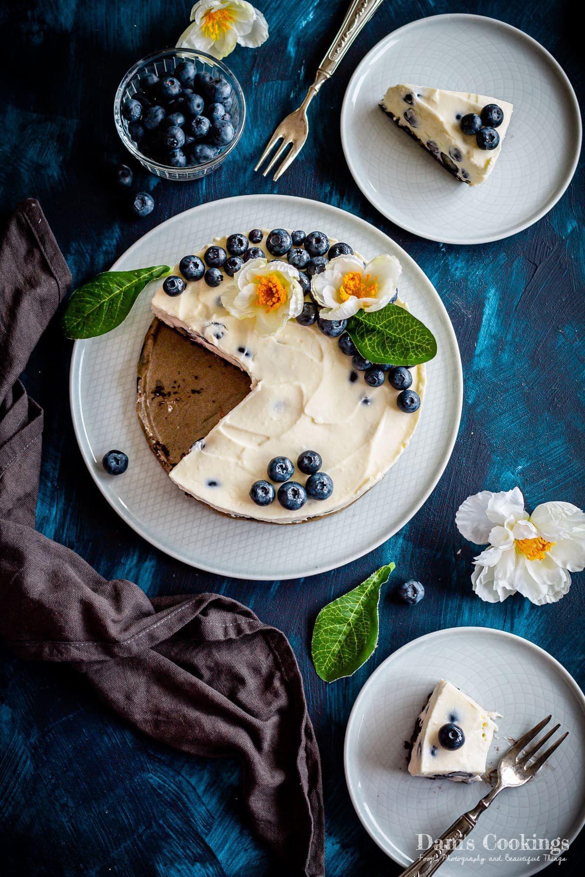 blueberry cheesecake with two slices aside, flat lay