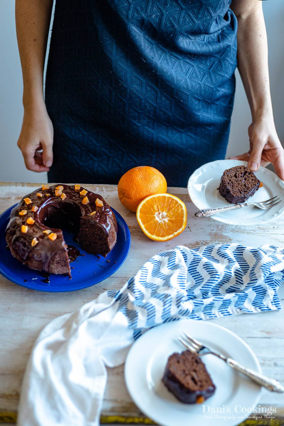 a woman with a slice of bundt cake on a plate