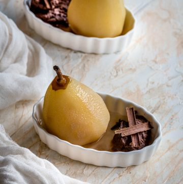 poached pears with chocolate mousse served in two ramekins