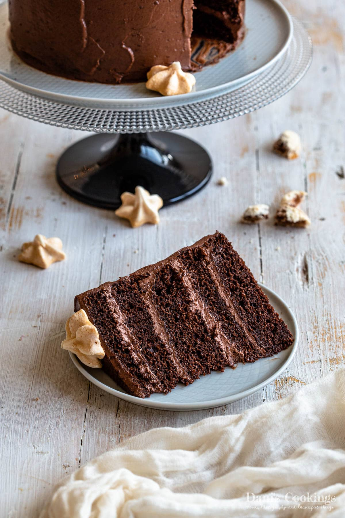 a slice of chocolate cake with meringues