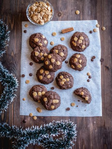 vegan chocolate cookies on a wooden background with christmas decoration