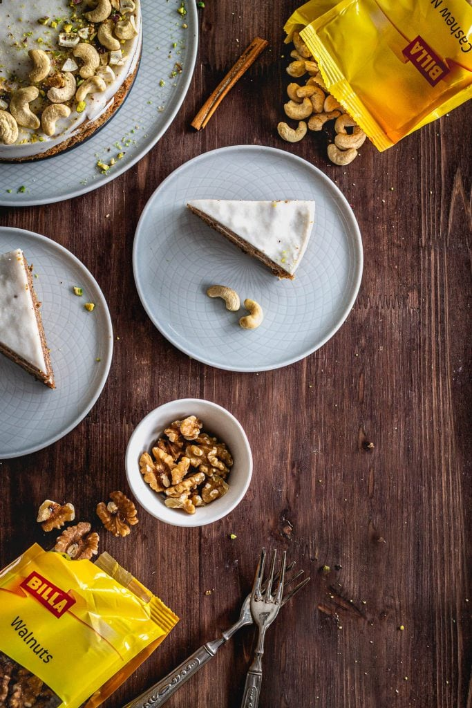 a flat lay image of cake slices with nuts aside